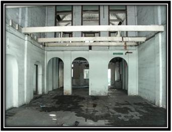 hollow delipitated interior of the office building fronting